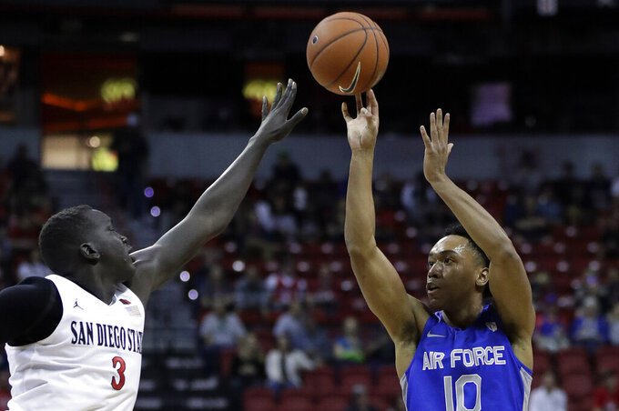 Air Force's A.J. Walker (10) shoots as San Diego State's Aguek Arop (3) defends during the first half of a Mountain West Conference tournament NCAA college basketball game Thursday, March 5, 2020, in Las Vegas. (AP Photo/Isaac Brekken)