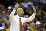 Texas head coach Shaka Smart directs his players during the first half of an NCAA college basketball game against Iowa State, Saturday, March 2, 2019, in Austin, Texas. (AP Photo/Eric Gay)