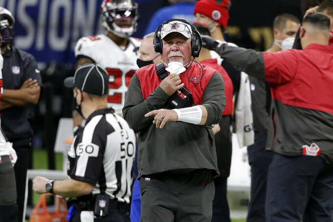 Tampa Bay Buccaneers head coach Bruce Arians speaks with field judge Aaron Santi (50) during the second half of his team's NFL divisional round playoff football game against the New Orleans Saints, Sunday, Jan. 17, 2021, in New Orleans. (AP Photo/Butch Dill)