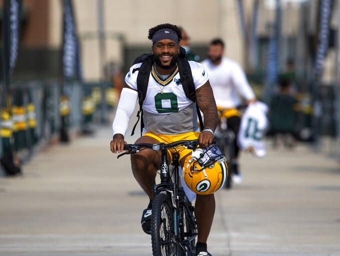 Green Bay Packers Amari Rodgers rides a bike from Lambeau Field to practice at NFL football training camp at Ray Nitschke Field, Wednesday, July 28, 2021, in Green Bay, Wis. (Samantha Madar/The Post-Crescent via AP)