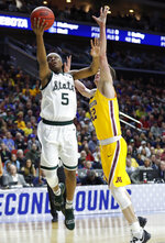 Michigan State guard Cassius Winston (5) drives to the basket past Minnesota forward Michael Hurt, right, during a second round men's college basketball game in the NCAA Tournament, Saturday, March 23, 2019, in Des Moines, Iowa. (AP Photo/Charlie Neibergall)