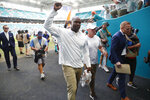 Miami Dolphins head coach Brian Flores walks off the field after his first win of the season after an NFL football game against the New York Jets, Sunday, Nov. 3, 2019, in Miami Gardens, Fla. (AP Photo/Wilfredo Lee)
