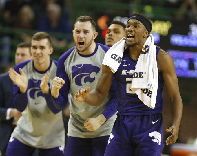 Kansas State guard Cartier Diarra, right, reacts to a score against Baylor in the second half of an NCAA college basketball game, Saturday, Feb. 9, 2019, in Waco, Texas. (Rod Aydelotte/Waco Tribune Herald, via AP)