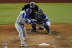 Los Angeles Dodgers first baseman Max Muncy hits a home run against the Tampa Bay Rays during the fifth inning in Game 5 of the baseball World Series Sunday, Oct. 25, 2020, in Arlington, Texas. (AP Photo/Sue Ogrocki)