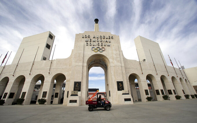 FILE - This Jan. 13, 2016 file photo shows the peristyle of the Los Angeles Memorial Coliseum in Los Angeles. United Airlines and the University of Southern California have reached a new naming rights agreement for Los Angeles Memorial Coliseum to resolve criticism that putting a corporate name on the stadium disrespects its role as a World War I monument. (AP Photo/Nick Ut, File)