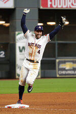 Houston Astros' George Springer celebrates after their win in Game 6 of baseball's American League Championship Series against the New York Yankees Saturday, Oct. 19, 2019, in Houston. The Astros won 6-4 to win the series 4-2. (AP Photo/Eric Gay)