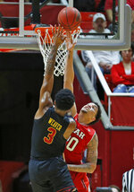 Utah forward Timmy Allen, rear, defends against Southern California guard Elijah Weaver (3) during the second half of an NCAA college basketball game Thursday, March 7, 2019, in Salt Lake City. (AP Photo/Rick Bowmer)