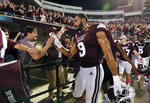 Mississippi State defensive end Montez Sweat (9) celebrates with fans following the team's NCAA college football game against Auburn in Starkville, Miss., Saturday, Oct. 6 2018. Mississippi State won 23-9. (AP Photo/Rogelio V. Solis)