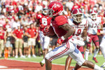Alabama wide receiver Henry Ruggs III (11) scores a touchdown on a pass reception during the first half of an NCAA college football game against New Mexico State, Saturday, Sept. 7, 2019, in Tuscaloosa, Ala. (AP Photo/Vasha Hunt)