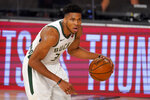 Milwaukee Bucks' Giannis Antetokounmpo (34) advances the ball up court against the Miami Heat during the second half of an NBA basketball conference semifinal playoff game, Monday, Aug. 31, 2020, in Lake Buena Vista, Fla. (AP Photo/Mark J. Terrill)