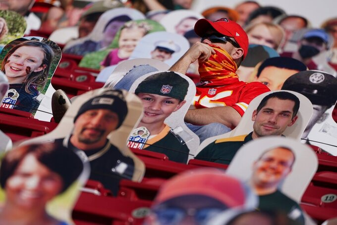 A Kansas City Chiefs fan looks on before the NFL Super Bowl 55 football game between the Kansas City Chiefs and Tampa Bay Buccaneers, Sunday, Feb. 7, 2021, in Tampa, Fla. (AP Photo/Charlie Riedel)