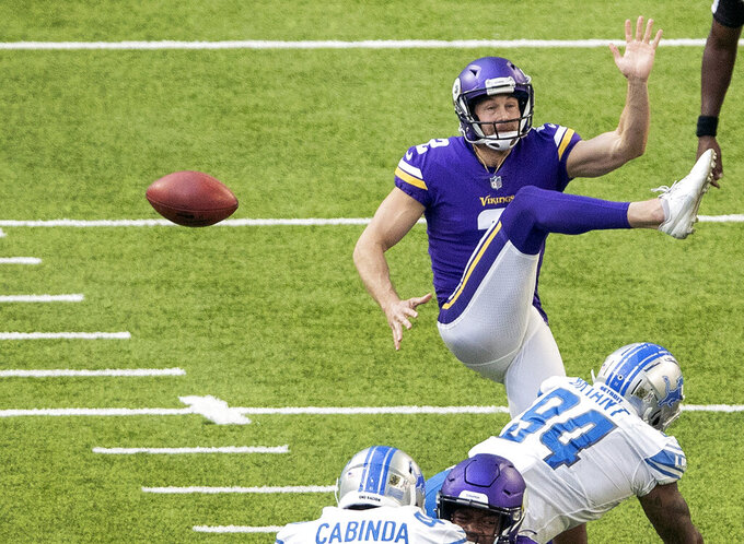 Detroit Lions Austin Bryant (94) blocks the punt by Minnesota Vikings Britton Colquitt (2) during the second half of an NFL football game, Sunday, Nov. 8, 2020 in Minneapolis. (Carlos Gonzalez/Star Tribune via AP)