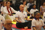 Israel's Ambassador to India Ron Malka, center wearing black trousers, performs yoga along with other diplomats from various countries to mark International Yoga Day in New Delhi, India, Friday, June 21, 2019. Prime Minister Narendra Modi successfully lobbied the United Nations to designate June 21 International Yoga Day in his first year in power in 2014. Most of India's 191 embassies and consulates worldwide organized yoga sessions to commemorate the day, according to the foreign ministry. (AP Photo/Altaf Qadri)