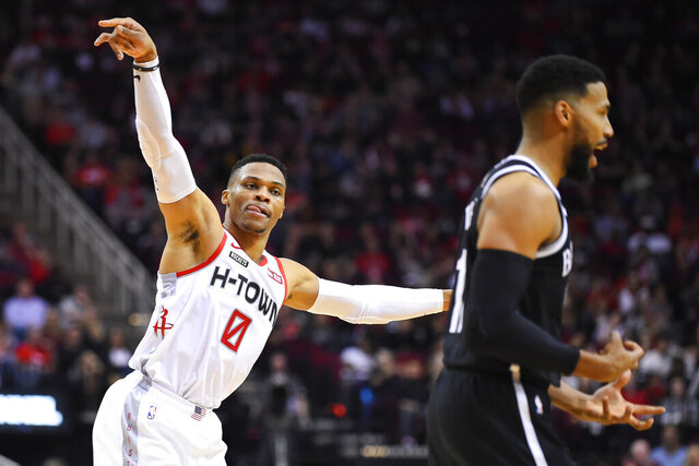 Houston Rockets guard Russell Westbrook (0) gestures toward Brooklyn Nets guard Garrett Temple after making a basket during the first half of an NBA basketball game Saturday, Dec. 28, 2019, in Houston. (AP Photo/Eric Christian Smith)