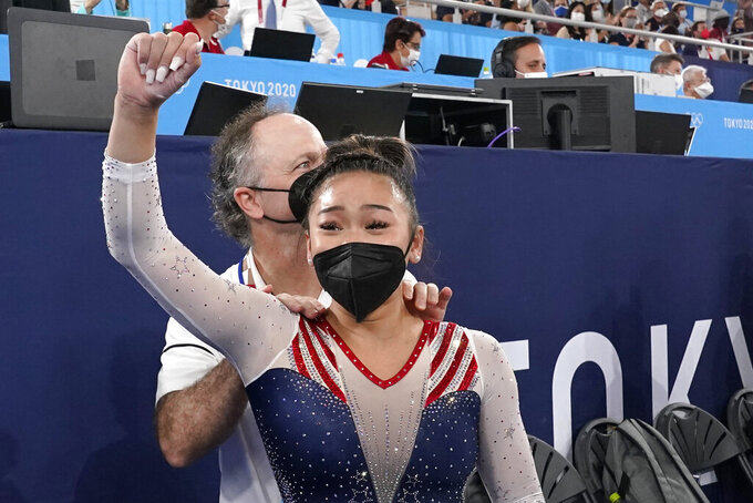Sunisa Lee, of the United States, celebrates with her coach Jeff Graba after she won the gold medal in the artistic gymnastics women's all-around at the 2020 Summer Olympics, Thursday, July 29, 2021, in Tokyo. (AP Photo/Gregory Bull)