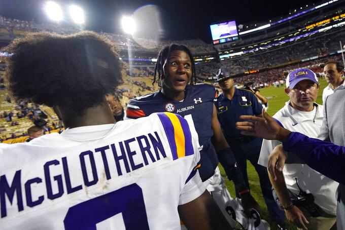 Auburn quarterback TJ Finley (1) greets former LSU teammates after an NCAA college football game in Baton Rouge, La., Saturday, Oct. 2, 2021. Auburn won 24-19. (AP Photo/Gerald Herbert)