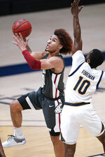 Washington State guard Isaac Bonton, left, drives to the basket against California guard Makale Foreman, right, during the first half of an NCAA college basketball game, Thursday, Jan. 7, 2021, in Berkeley, Calif. (AP Photo/Tony Avelar)