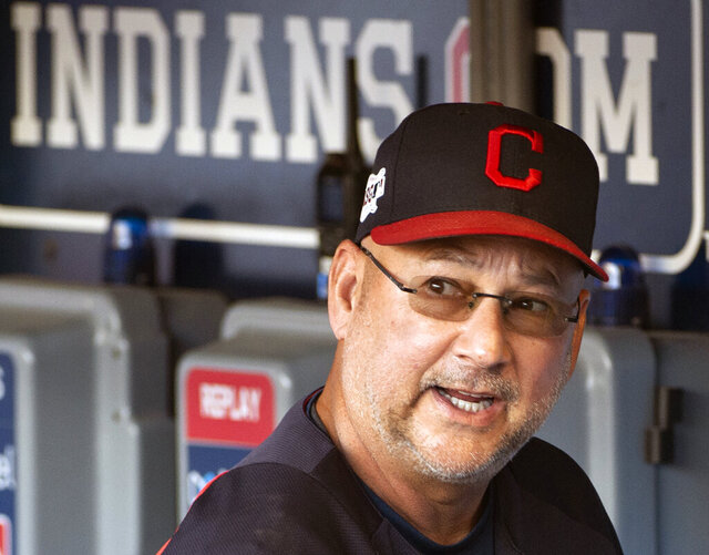 FILE - This is a Sunday, Sept. 22, 2019, file photo showing Cleveland Indians manager Terry Francona talking before a baseball game against the Philadelphia Phillies in Cleveland. Baseball is back, but because of the coronavirus, official scorers will work remotely this season to rule on hits and errors, make other judgments and tabulate box scores. Francona said the game slows down as you get farther away from the action, which affects judgment on deciding whether a play should be a hit or an error. So he's not keen on scorers working from home.(AP Photo/Phil Long, File)