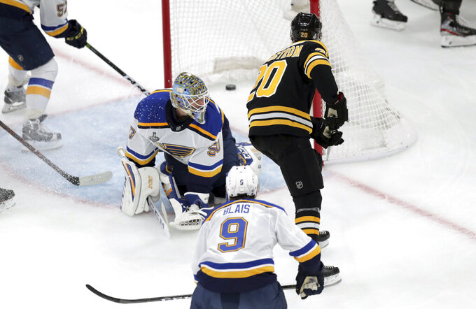 Boston Bruins' Joakim Nordstrom (20), of Sweden, scores a goal past St. Louis Blues goaltender Jordan Binnington, left, during the first period in Game 2 of the NHL hockey Stanley Cup Final, Wednesday, May 29, 2019, in Boston. (AP Photo/Charles Krupa)
