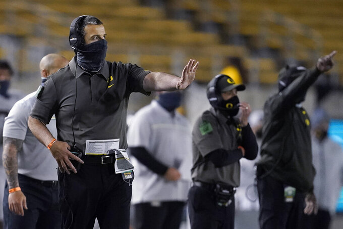 Oregon coach Mario Cristobal gestures during the second half of the team's NCAA college football game against California in Berkeley, Calif., Saturday, Dec. 5, 2020. (AP Photo/Jeff Chiu)