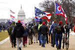 FILE - In this Wednesday, Jan. 6, 2021, file photo, supporters of President Donald Trump march towards the Capitol holding flags during rally in Washington. War-like imagery has begun to take hold in mainstream Republican political circles in the wake of the deadly attack on the U.S. Capitol, with some elected officials and party leaders rejecting calls to tone down their rhetoric contemplating a second civil war. (AP Photo/Carolyn Kaster, File)