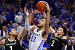 Kentucky's EJ Montgomery (23) shoots while defended by Vanderbilt's Dylan Disu (1) and Scotty Pippen Jr. (2) during the second half of an NCAA college basketball game in Lexington, Ky., Wednesday, Jan 29, 2020. Kentucky won 71-62. (AP Photo/James Crisp)