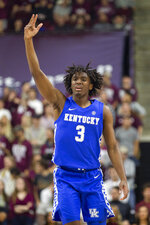 Kentucky guard Tyrese Maxey (3) reacts after making a 3-point basket against Texas A&M during the first half of an NCAA college basketball game Tuesday, Feb. 25, 2020, in College Station, Texas. (AP Photo/Sam Craft)