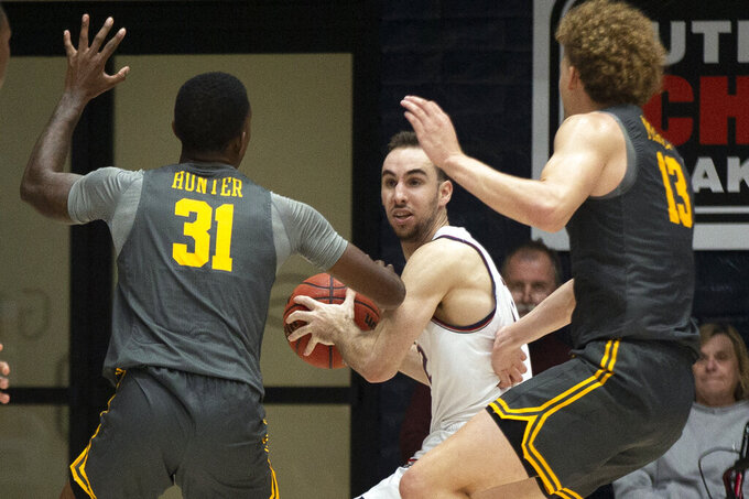 Saint Mary's guard Tommy Kuhse (12) looks for an open man between Long Beach State guard Chance Hunter (31) and forward Romelle Mansel (13) during the second half of an NCAA college basketball game Thursday, Nov. 14, 2019, in Moraga, Calif.  (AP Photo/D. Ross Cameron)