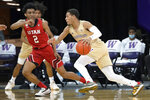 Washington guard Quade Green (55) drives past Utah guard Ian Martinez (2) during the second half of an NCAA college basketball game, Sunday, Jan. 24, 2021, in Seattle. Washington won 83-79. (AP Photo/Ted S. Warren)