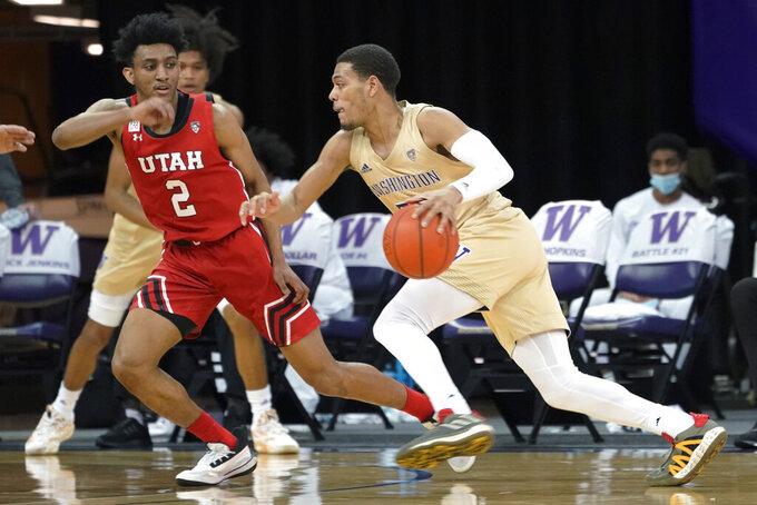 Washington guard Quade Green (55) drives past Utah guard Ian Martinez (2) during the second half of an NCAA college basketball game, Sunday, Jan. 24, 2021, in Seattle. Washington won 83-79. (AP Photo/Ted S. Warren)