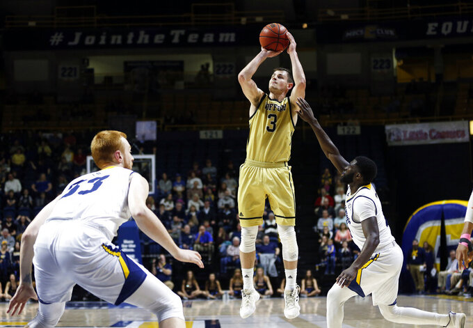 Wofford guard Fletcher Magee (3) shoots as he's defended by Chattanooga guard David Jean-Baptiste, right, during the first half of an NCAA college basketball game Thursday, Feb. 28, 2019, in Chattanooga, Tenn. (AP Photo/Wade Payne)