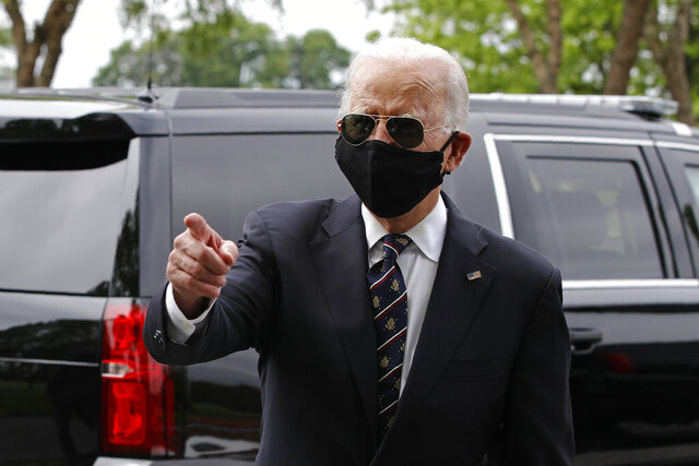 Democratic presidential candidate, former Vice President Joe Biden speaks with visitors after placing a wreath at the Delaware Memorial Bridge Veterans Memorial Park with Jill Biden, Monday, May 25, 2020, in New Castle, Del. (AP Photo/Patrick Semansky)