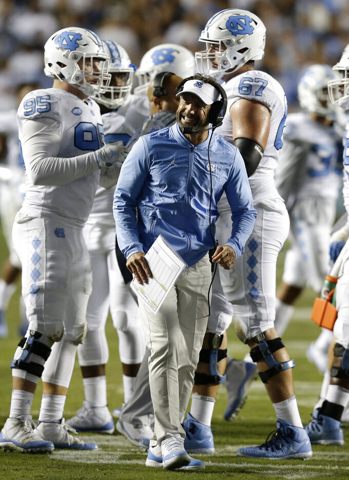 FILE - In this Oct. 13, 2018, file photo, North Carolina head coach Larry Fedora reacts against Virginia Tech during the first half of an NCAA college football game, in Chapel Hill, N.C. North Carolina (1-5) plays at Virginia (5-2) on Saturday, Oct. 27.  (AP Photo/Gerry Broome, File)