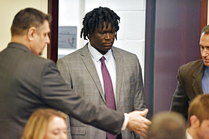 Emanuel Kidega Samson, 27, center, enters the courtroom Monday, May 20, 2019, in Nashville, Tenn. Samson is accused of fatally shooting a woman and wounding seven people at a Nashville church in 2017. Prosecutors have said they're seeking life without parole for Samson. (George Walker IV/The Tennessean via AP, Pool)