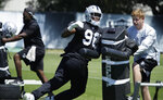 Oakland Raiders' Clelin Ferrell (96) performs a drill during NFL football practice on Tuesday, June 4, 2019, at the team's training facility in Alameda, Calif. (AP Photo/Ben Margot)