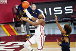 Oklahoma guard De'Vion Harmon (11) goes to the basket in front of West Virginia guard Miles McBride, right, in the first half of an NCAA college basketball game Saturday, Jan. 2, 2021, in Norman, Okla. (AP Photo/Sue Ogrocki)