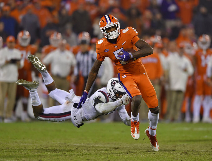 Clemson's Tee Higgins (5) outruns the tackle attempt by South Carolina's R.J. Roderick during the second half of an NCAA college football game Saturday, Nov. 24, 2018, in Clemson, S.C. (AP Photo/Richard Shiro)
