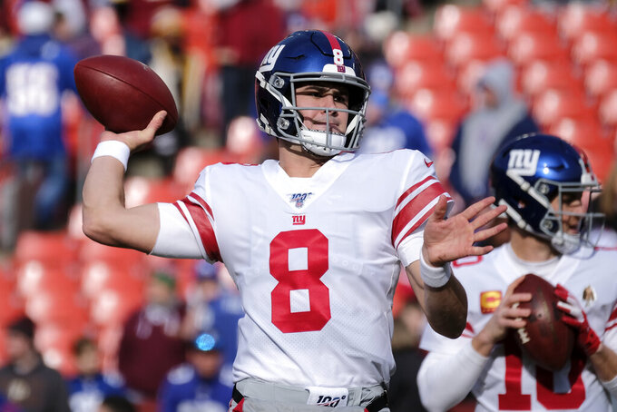 FILE - In this Sunday, Dec. 22, 2019 file photo, New York Giants quarterback Daniel Jone warms up prior to an NFL football game against the Washington Redskins in Landover, Md. Jones seemingly has plenty of targets for his second season with Darius Slayton, Golden Tate and Sterling Shepard returning at wide out and Evan Engram at tight end. (AP Photo/Mark Tenally, File)