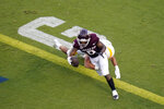 Texas A&M wide receiver Ainias Smith (0) crosses the goal line for a touchdown as Kent State linebacker A.J. Musolino tries to tackle him during the first quarter of an NCAA college football game on Saturday, Sept. 4, 2021, in College Station, Texas. (AP Photo/Sam Craft)