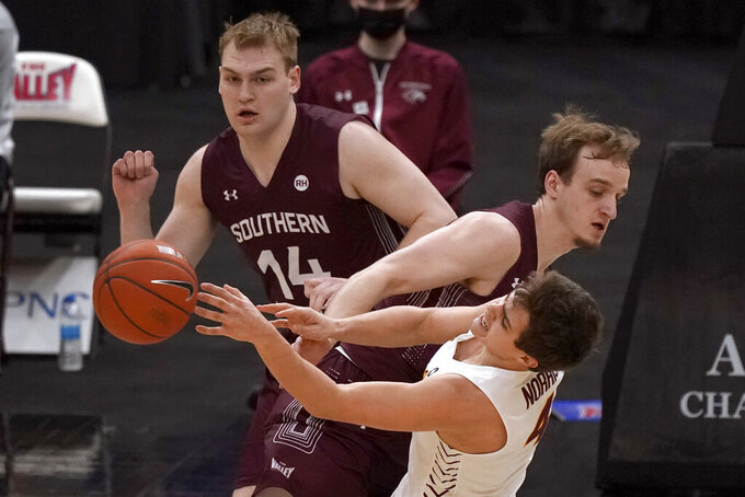Loyola of Chicago's Braden Norris (4) passes as Southern Illinois' Ben Harvey (10) and Kyler Filewich (14) defend during the first half of an NCAA college basketball game in the quarterfinal round of the Missouri Valley Conference men's tournament Friday, March 5, 2021, in St. Louis. (AP Photo/Jeff Roberson)