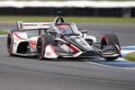 Rinus VeeKay, of the Netherlands, drives into an turn during a IndyCar auto race at Indianapolis Motor Speedway, Friday, Oct. 2, 2020, in Indianapolis. (AP Photo/Darron Cummings)