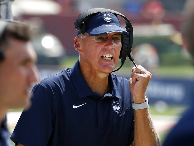 FILE - In this Aug. 28, 2021, file photo, Connecticut coach Randy Edsall coaches his team against Fresno State during the second half of an NCAA college football game in Fresno, Calif. Edsall, whose teams have won just six games since he returned to the Huskies for a second stint as coach in 2017 has announced that he will retire at the end of the season. (AP Photo/Gary Kazanjian, File)