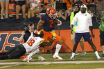 Illinois running back Chase Brown (2) is tackled out of bounds by Maryland defensive back Jordan Mosley (18) off a pass from quarterback Brandon Peters during the first half of an NCAA college football game Friday, Sept. 17, 2021, in Champaign, Ill. (AP Photo/Charles Rex Arbogast)