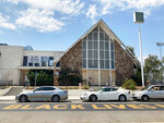 Cars are parked outside the boarded-up First Baptist Church of Venice on Sunday, July 11, 2021, in Los Angeles. Residents of Venice are seeking to preserve the church. The century-old congregation is a symbol for the Black residents that lived in Oakwood, the only area near the beach where Africa's Americans were historically allowed to buy and own property. (Alejandra Molina/RNS via AP)