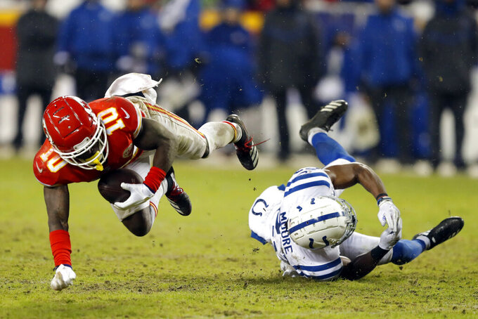 Kansas City Chiefs wide receiver Tyreek Hill (10) is tripped by Indianapolis Colts cornerback Kenny Moore (23) during the second half of an NFL divisional football playoff game in Kansas City, Mo., Saturday, Jan. 12, 2019. (AP Photo/Charlie Neibergall)