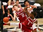 Stanford forward Max Murrell (10), guard Daejon Davis (1), and Washington State center Dishon Jackson (21) fight for a rebound during the first half of an NCAA college basketball game, Saturday, Feb. 20, 2021, in Pullman, Wash. (AP Photo/Pete Caster)