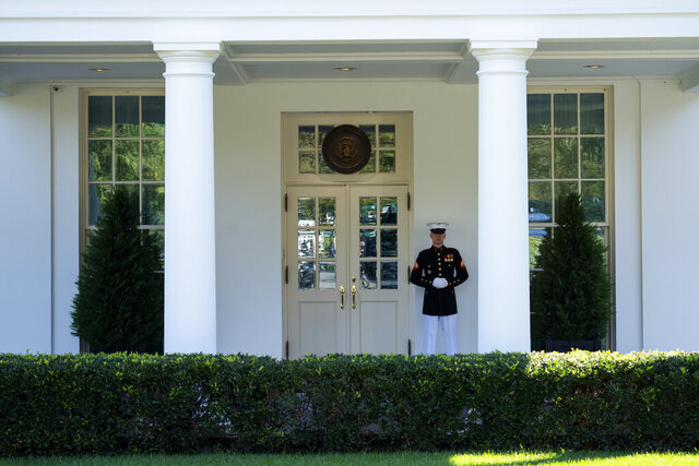 A Marine is posted outside the West Wing of the White House, signifying the President is in the Oval Office, Wednesday, Oct. 7, 2020, in Washington. (AP Photo/Evan Vucci)