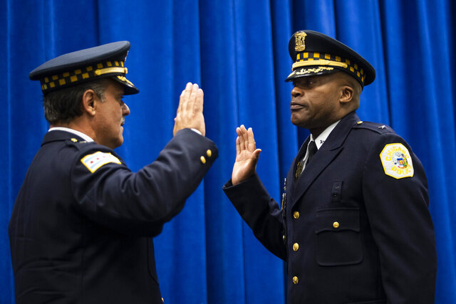 In this July 15, 2020, photo, retiring Chicago Police Department First Deputy Superintendent Anthony Riccio, left, swears in newly-promoted Deputy Chief of Criminal Networks Dion Boyd during a promotion ceremony at CPD headquarters in Chicago. Boyd has been found dead after he apparently shot himself in a station on the city's West Side.  (Ashlee Rezin Garcia/Chicago Sun-Times via AP)