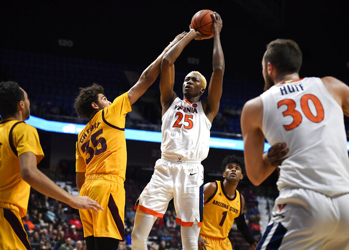 Virginia's Mamadi Diakite (25) shoots over Arizona State's Taeshon Cherry (35) during the first half of an NCAA college basketball game, Sunday, Nov. 24, 2019, in Uncasville, Conn. (AP Photo/Jessica Hill)2