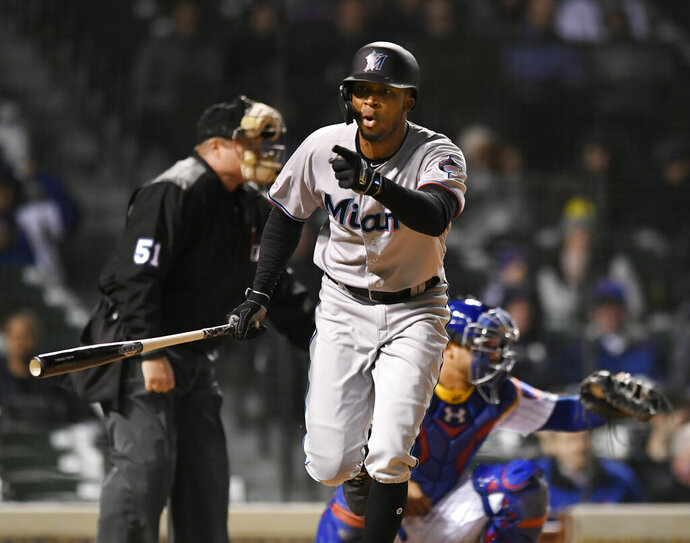 Miami Marlins' Rosell Herrera reacts after being walked which scored Curtis Granderson during the ninth inning of a baseball game against the Chicago Cubs, Monday, May 6, 2019, in Chicago. Miami won 6-5. (AP Photo/Paul Beaty)